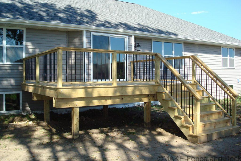 Green treated decking and rails with round metal balusters