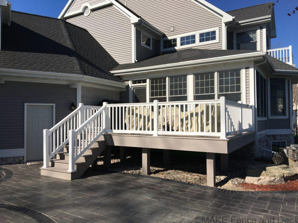 Azel Slate Gray decking with white vinyl railing.