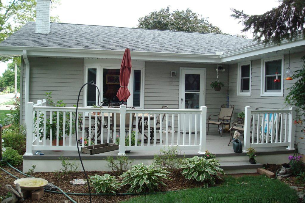 Gray Azek decking with white vinyl railing