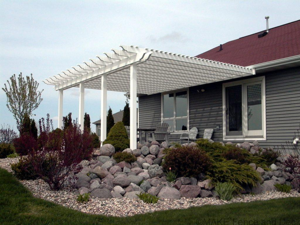 white vinyl pergola attached to house