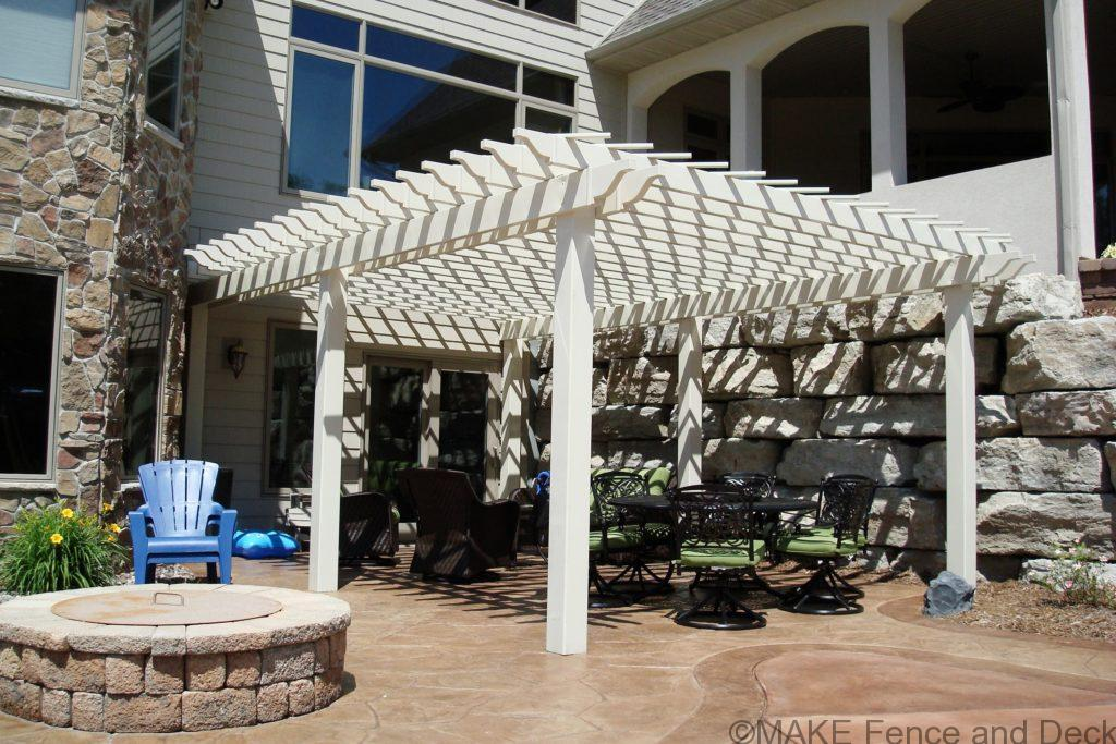 "Large tan vinyl pergola with 6"" posts and laths for shade."