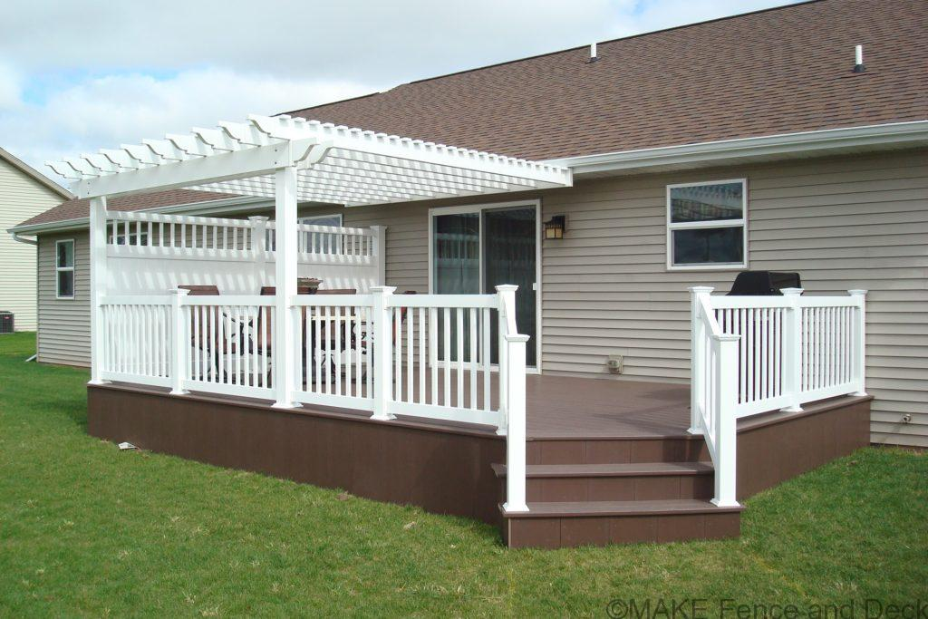 White vinyl pergola mounted on deck attached to house
