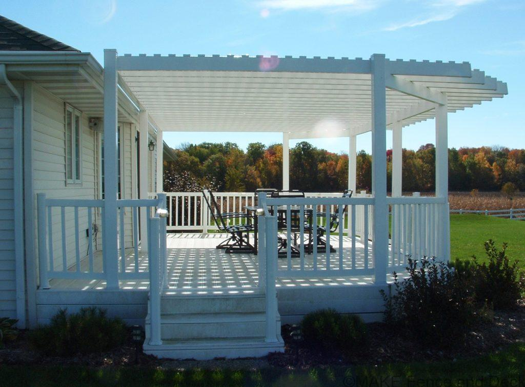 white vinyl pergola mounted on vinyl deck