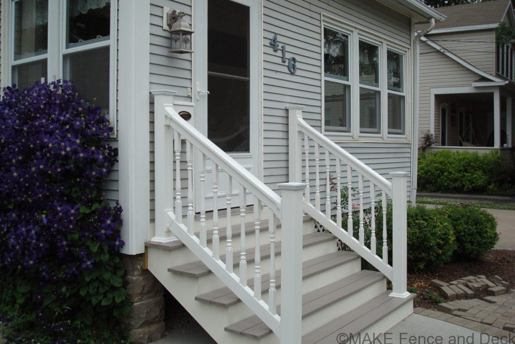 "White vinyl railing consisting of Big-T top rail and 2"" x 3 ½"" bottom rail with 1 ½"" turned style balusters."