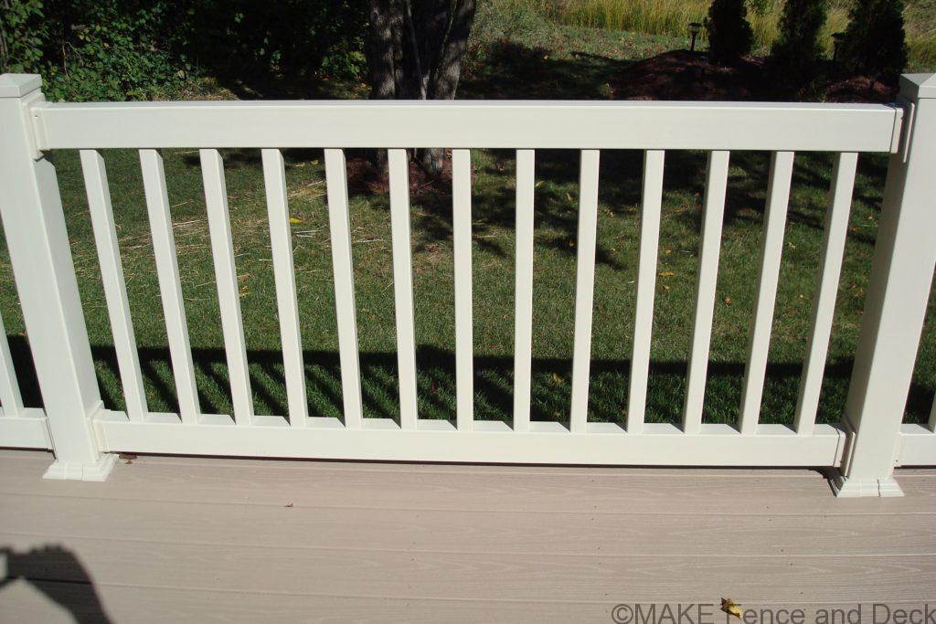 "White vinyl railing consisting of 2"" x 3 ½"" top and bottom rail with 1 ½"" square balusters."