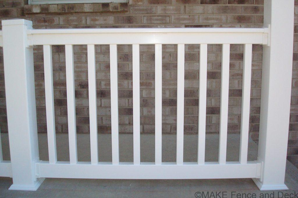 "White vinyl railing consisting of Big-T top rail and 2"" x 3 ½"" bottom rail with 1 ½"" square balusters."